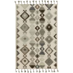 TLL-3003 - Dimensional, updated nomadic southwest, flat weave with tufted motif and tassels