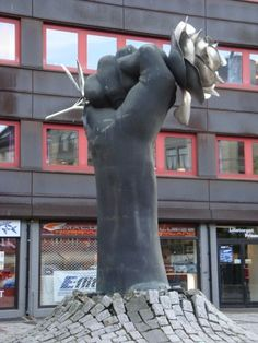 Ola Enstad's sculpture 'Neve og rose' (English: 'Fist and Rose') from 1991 is located at Lilletorget, a square in Oslo, Norway.