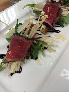 an iphone snap - for our spring & summer 2014 menu - tenderloin/Enoki rolls, arugula, hint of truffle.