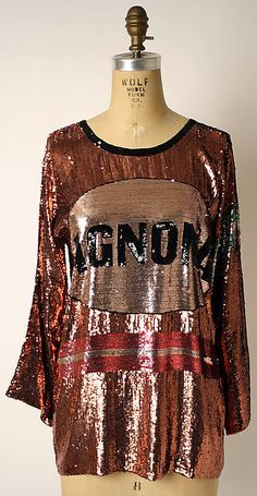Shirt Designer: Geoffrey Beene  (American, Haynesville, Louisiana 1927–2004 New York) Date: ca. 1976 Culture: American Medium: silk, plastic Dimensions: Length at CB: 24 in. (61 cm)