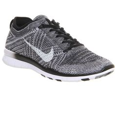 Nike Free Tr Flyknit ($160) ❤ liked on Polyvore featuring shoes, athletic shoes, nike, trainer, black white wolf grey, hers trainers, black white shoes, grey shoes, athletic running shoes and nike athletic shoes