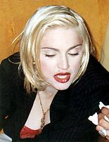 Rising pop star, Madonna proved to be very influential to the fashion in 80s. Her look includes short skirts over leggings, necklaces, rubber bracelets, fishnet gloves, head bands, and lace ribbons.
