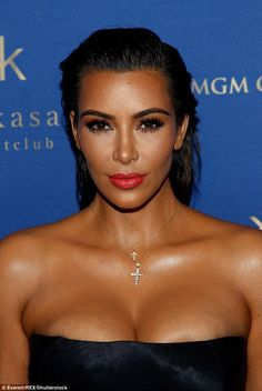 Tanned: Going heavy on the bronzer and contour, the reality star added a touch of highlighter under her eyes and a pop of vibrant red lipgloss