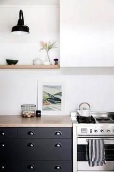 clean and minimalistic styled kitchen but I love the striped towel and the teapot