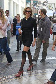 Eliza Coupe in adorable black mini dress and preppy black thigh high tights and heeled oxfords. Super playful and a little cheeky ;)