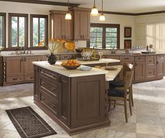 Sophistication and taste are brought to life by the Riverbed finish on these elegant Omega cherry Laroche cabinets. This kitchen suits a variety of design preferences, which is why you can rely on the subtlety of detail for a look that is easy to love.