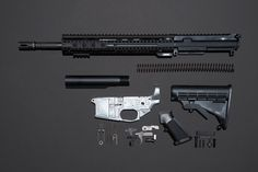 All the components of my AR-15, including my homemade lower receiver, the gleaming aluminum piece.