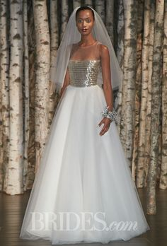 "Brides.com: . ""Milan"" sleeveless tulle ball gown wedding dress with an illusion high neckline and horizontal beading on the bodice, Naeem Khan"