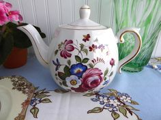 This is an Ellgreave, a division of Wood and Sons, Staffordshire England English ironstone large 4 to 6 cup or 36 oz teapot with a pretty design of an almost Jacobean floral design on both sides with