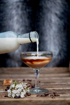 Tiramisu ~  Ice Coffee extract or a splash of espresso.  Amaretto   Milk chocolate liqueur White chocolate liqueur Sprinkle of cocoa powder Lady finger to serve