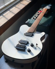 An original, classic design that is familiar to all fans of great guitars. The Sterling by Music Man Axis features two double humbucking pickups, an asymmetrical neck, and a vintage style tremolo. This guitar sports a snazzy white finish with black binding. Available now at elderly.com.