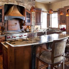 gorgeous tuscan colored stove hood in this Custom Kitchen  - JM Kitchen and Bath Denver Castle Rock CO