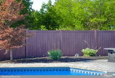 Best new pool fence idea. Grand Illusions Vinyl WoodBond PVC vinyl wood grain fence. Shown in Walnut grain. #poolideas #fenceideas #backyardideas #homeideas #HGTV #illusionsfence