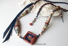 Polymer clay focal and beads and paper bead cones handmade by Debra of DatzKatz featured in this necklace created by Debra of DatzKatz