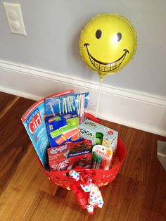 Made this for a little girl getting braces. All items from the dollar store: basket, a balloon we drew a smiley braces smile, frozen ice pops, fun Chapstick, pudding, straws with umbrellas, (American girl magazine from bookstore). It was a huge hit!  Keywords: braces, gift for braces, braces party
