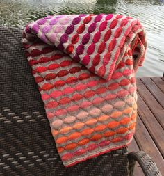 Colorful decorative knit blanket w soft merino hand dyed yarn in shades of…