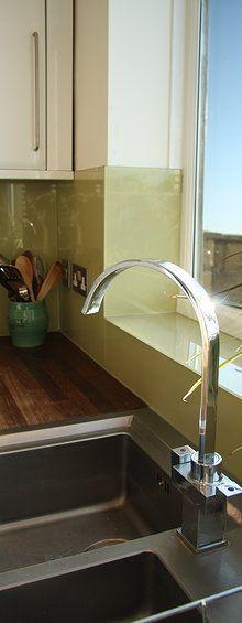 Glass splashback near window
