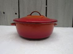 Mid Century Descoware Flame Orange Red Enamelware mini casserole, red enamelware casserole, vintage Belgium casserole, 2roads2take   This would make a cute Get well gift for someone who has a cold. Put a spot of soup in as a single serving then let your enamelware collector keep the pot!  Manufactured: • Material: enamelware • Color: red, creme, black • Product Dimensions: 4t all x 6 wide • Product Weight: lb 13 oz • Condition: Good Vintage • Ships from: Tampa Fl(92A) • International buys…