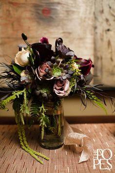 Succulents, Amnesia Roses, Calla lilies, Agonis, Monkey Tail, Hanging Amaranthus, Flat fern, Lisianthus, Berzelia