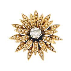 Antique Diamond, Split-Pearl and 14K Gold Brooch/Pendant, circa 1900  The flowerhead centering an old European-cut diamond weighing approximately 1.00 carat, surrounded by graduated split-pearl petals, with hinged pendant loop to the reverse, mounted in 14k gold