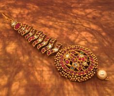 Traditional Maang tikka with rubies uncuts emeralds Contact no 7380009000 . 9000275540 What's app no 8801558661 Tikka Jewelry, Silver Jewellery Indian, Indian Wedding Jewelry, Bead Jewellery, Silver Jewelry, Jewelery, Silver Rings, Gold Hair Accessories, Bridal Jewelry Sets