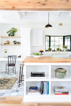 Bright kitchen with light wood accents and island storage.