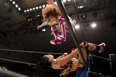 Kairi Hojo jumps at her opponent Mieko Satomura