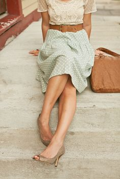 Lace shirt, belted mint polka dot skirt.