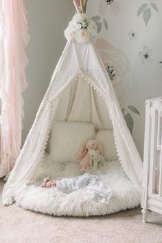 Lace cream teepee with newborn for newborn photography shoot in nursery.