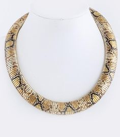 This gorgeous snake skin print necklace was destined to make an appearance on your neck.    snake, animal print, necklace, jewelry, accessories, fashion, style, hot, trendy