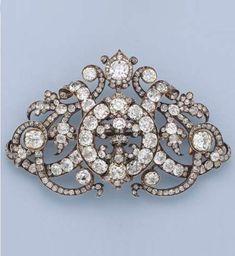 A VERY FINE ANTIQUE DIAMOND CORSAGE BROOCH, CIRCA 1860. Designed with a centred…