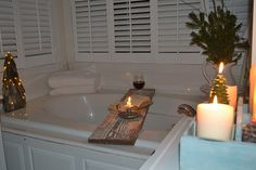 Love the shabby chic bath tray made from a board.