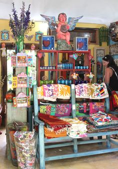 Mixtik (Boca Paila Road. km 5)- has a more carefully curated selection of art, textiles, pottery, and knick-knacks. the prices seemed better here, too.