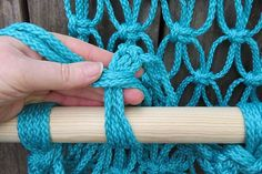 Wrap the cords around the dowel and tie a knot.