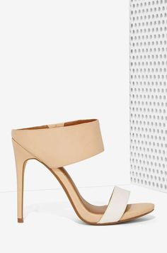 We're totally obsessed with mules this season, so we decided to design a badass pair of our own. They're nude beauties with nude and white s...