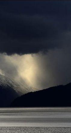 Sunshine breaks through the dark clouds over the Chugach and Kenai Mountains and Turnagain Arm along the Seward Highway south of Anchorage, Alaska, on Thursday, May 4, 2017. (Bob Hallinen / Alaska Dispatch News)