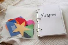 I love this!  Kids can velcro shapes to the correct pages ... easy to make and nice center idea.