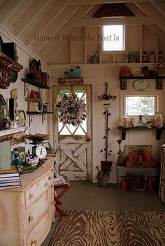 Potting Shed interior, faux bois indoor/outdoor rug, chalk painted chest, seed catalog wreath DIY Cool Sheds, Garden Catalogs, Seed Catalogs, Potting Sheds, Potting Benches, She Sheds, Shed Design, Garden Design, Shed Plans