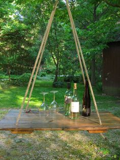 HANGING TABLE- Old barn wood hay DOOR- transformed into a beautiful hanging table- anthropoligie inspired by Jess. $199.00, via Etsy.