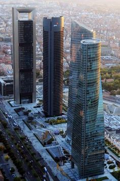 An aerial view of the Four Towers Business Area of Madrid, Spain. This is a landmark group of 4 contemporary skyscrapers, the tallest by Architect, Norman Foster.