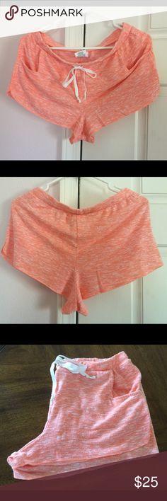 Aero Comfy Shorts Color: Orange/multi. Drawstring to adjust the waistline. 2 front pocket. Washed but never worn. 71% rayon, 25% polyester & 4% spandex. Aeropostale Shorts