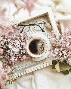 Coffee and flowers, perfect way to wake up.