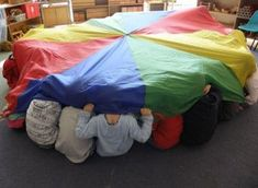 musical parachute play for little ones - love the boa constrictor song!