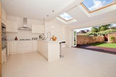 Rear extension - if we extend whole wall. Leaves room for upgrading kitchen down the road. Like the skylights.