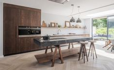 The best kitchen design ideas for your home in This expert trends round up reveals the latest modern kitchen ideas and contemporary kitchen trends from storage to two-tone kitchens. Walnut Kitchen, White Kitchen Cabinets, Island Kitchen, Dark Cabinets, Kitchen Cabinetry, Kitchen Appliances, Best Kitchen Designs, Modern Kitchen Design, Home Decor Kitchen