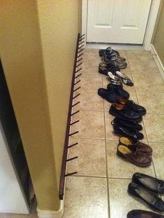 Shoe Rack: Well my wife wanted something to get the shoes off the floor and organized but also not bulky. I had looked at doing the 'coat rack' shoe hanger but I wanted 20 hooks so that was going to be expensive so I created this. Wall Shoe Rack, Shoe Hanger, Diy Shoe Rack, Hanger Rack, Shoe Racks, Diy Shoe Storage, Laundry Room Storage, Storage Ideas, Coat And Shoe Storage