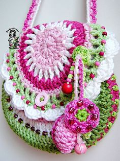 Garden Scene - Flower Purse, by Vendula Maderska.  Check out her designs page on Ravelry.