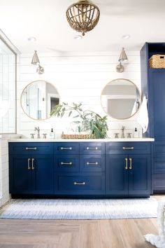 Boho farmhouse ranch master bathroom THE LIFESTYLED COMPANY-Casa De Lee Project #casadeleeproject Hale Blue cabinets, blue cabinets, navy cabinets, shiplap, brass round mirrors, vertival subway tile, bead chandelier, cement tile