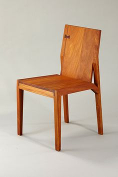 """Clean geometry conveys sturdiness, but the drama of the wood grain unfolds on every surface. Each chair is sustainably sourced from Frijolillo, Nanciton and other tropical trees felled during a 2007 hurricane in Nicaragua. """""""