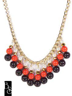 Maxi collar en tonos marrón, dorado y perlas.